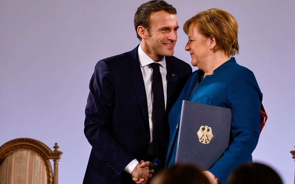 German Chancellor Angela Merkel and French President Emmanuel Macron sign the Aachen Treaty on January 22, 2019
