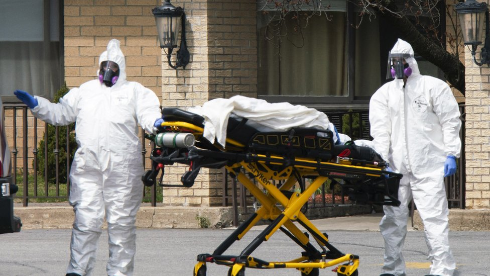 Medical workers load a deceased body into an ambulance at Andover Subacute and Rehabilitation Centre on 16 April 16 2020 in Andover, New Jersey, USA.