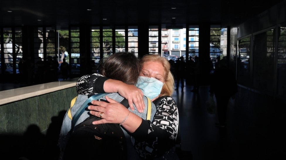 A mother and daughter embrace after the arrival of the first high-speed train connecting Turin and Reggio Calabria