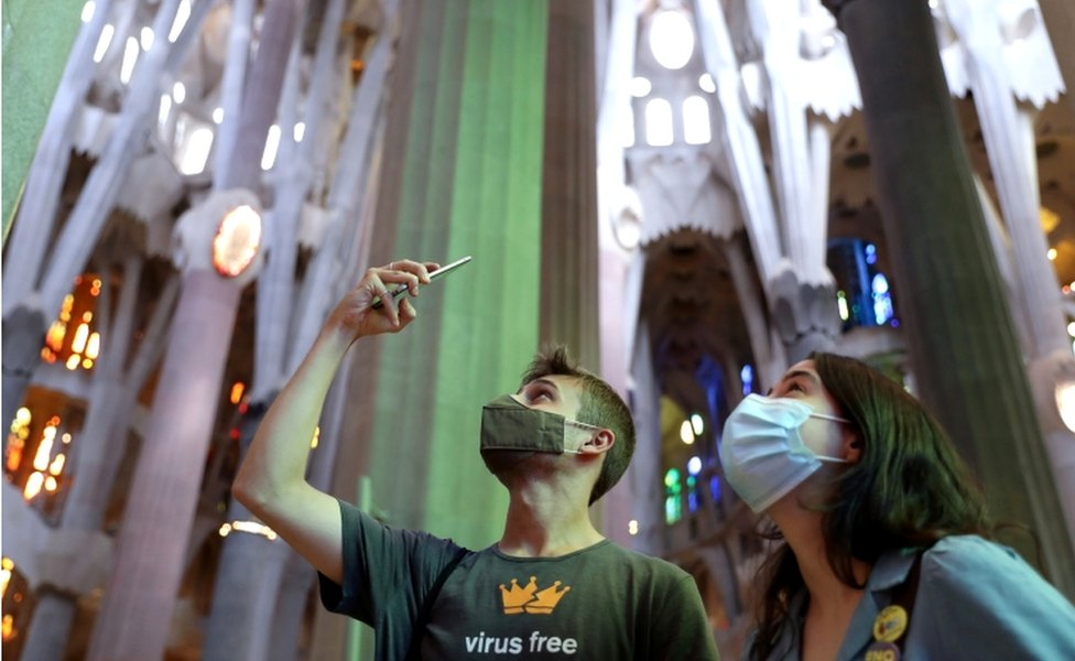 Visitors to the Sagrada Familia basilica in Barcelona, Spain