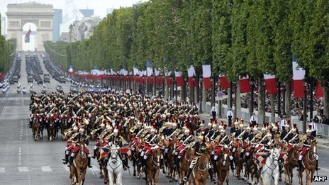 French Republican Guard ride their horses down the Champs-Elysees during the annual Bastille day parade in Paris on 14 July 2011