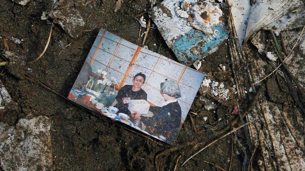 A pciture of a woman found among the debris of the 2011 tsunami in Japan
