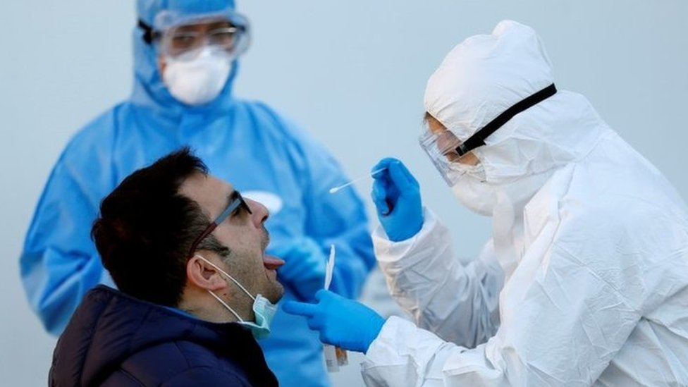 A man is tested for coronavirus in Rome