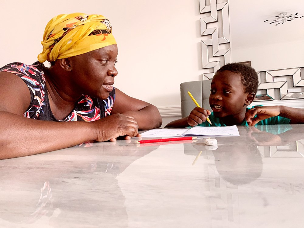 A mother home-schooling her son