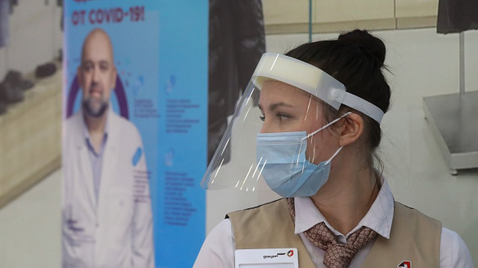 A staff member at the entrance to a temporary Covid-19 vaccination site in the Gagarinsky shopping and leisure centre