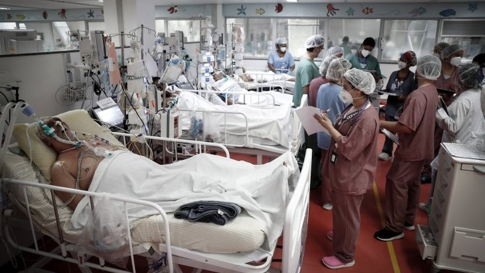 Medical personnel work at the ICU of the M'Boi Mirim Hospital, outskirts of Sao Paulo, Brazil, 12 March 202