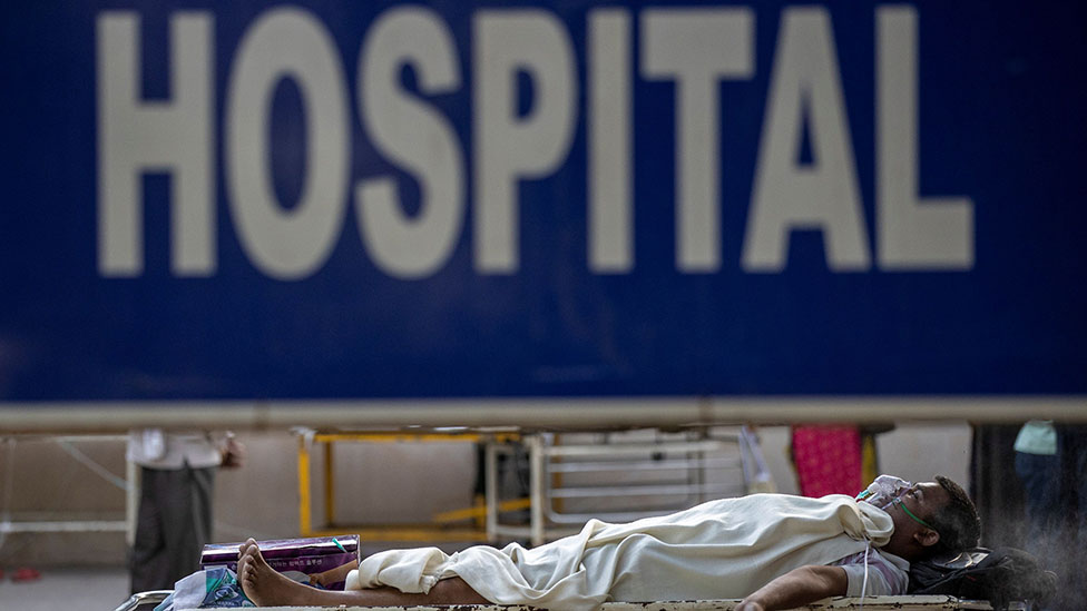 Patient outside a hospital in India